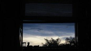 Com uma vista do pôr-do-sol